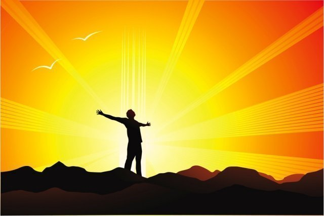 figure with outstretched arms in sunrise - represents awakening your soul with hypnotherapy and mind coaching