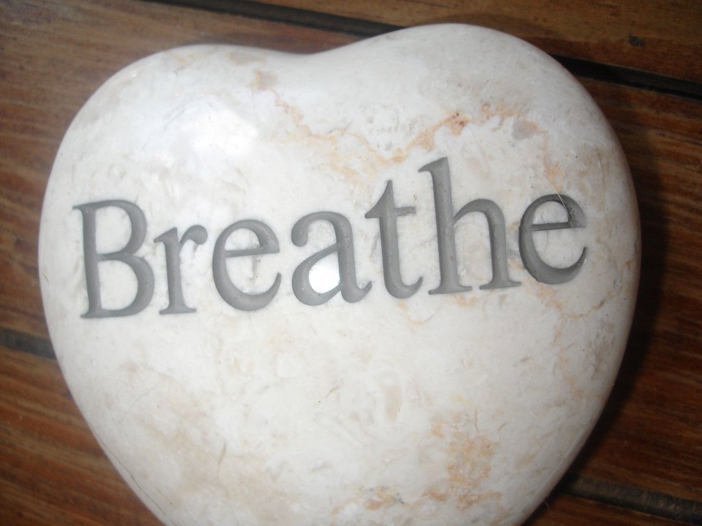 stone heart with the word 'breathe' on it
