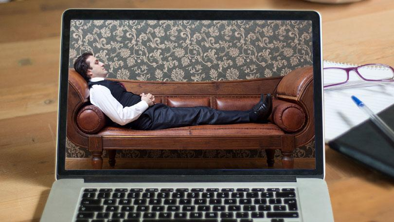 online therapy sessions - man relaxing on a couch on desktop screen