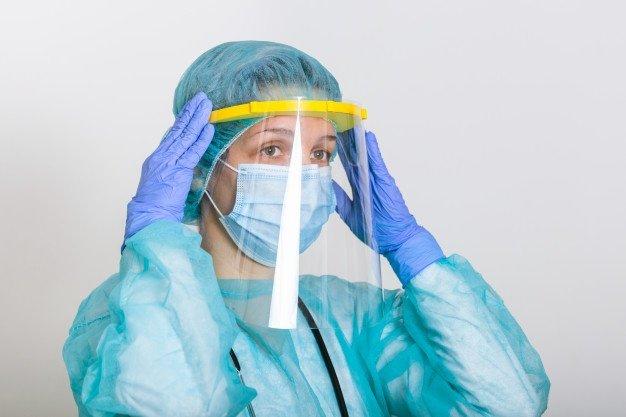 woman wearing PPE