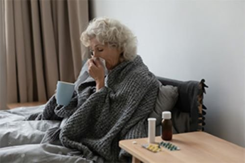 woman recovering from illness in bed