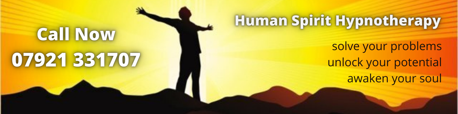 spiritual awakening: man with outstretched arms in silhouette